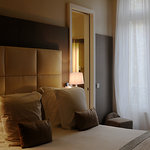 "Our standard ""classique"" room, bedside"