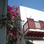 Balconies stretch over the narrow streets spilling bougainvillea from their terraces.