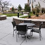 The courtyard area faces a park that lines the Arkansas River.