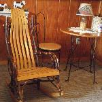 Interior sitting area of cottage showing handmade chair.