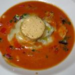  Braised ox tail raviolis in lobster bisque topped with foie gras