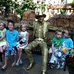 """""""grands"""" sitting by a golden cowboy statue"""