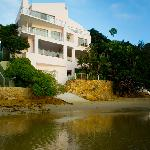 Milkwood Bay Exterior - as seen from the lagoon, a small secluded private patch of beach under t