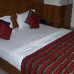 Bed and  linen in a room