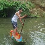 Trying to stand on the canoa