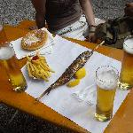Fish on a stick, very tasty, with beer