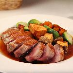 Seared Duck Breast with an Apple Cider Reduction Sauce with Crisp Potatoes, Butternut Squash and