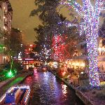 view of river walk at night.