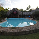  The view of the pool and patio/garden area at the front of El Sol Azul Guesthouse in Las Galeras