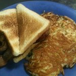 Bacon and Egg Toasted Sandwich with a side of hashbrowns..Yummy