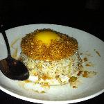 fried rice with egg on top garnished with crispy flakes of garlic