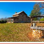 A log cabin that is up for rent near the vineyard