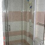 Hot Water & See-Through Shower Stall
