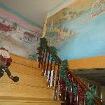 Hand-painted mural on stairway leading to rooms