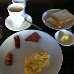 One of the breakfast options - scrambled eggs with bacon, sausage, ham, coconut toast & tea