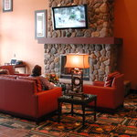 stay warm by our lobby fireplace