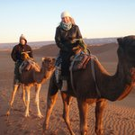 Camel riding at sunrise