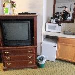 tv, microwave, fridge and sink