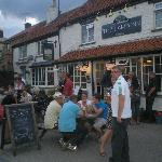 The local cricket lads enjoy another victory and a well earned pint.