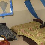 Triple beds with mosquito nets