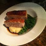 Roast belly of pork, mash and greens