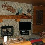#106--Leather furniture, big screen TV & gas log fireplace.