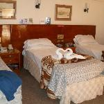 Quieter, south-facing corner rooms have 3 beds!