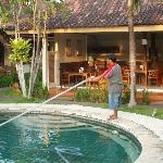 Ketut giving the pool the morning vaccumcleaning