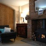 Cosy armchair and wood burning stove
