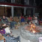 Camp fire party on the terrace with guests and friends