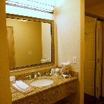 Sink in alcove across from shower / commode room had ample counter space.