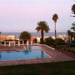 Hotel Atlantide view from room over pool to sea at dawn