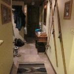 hallway from the common area to the front door and to the bedrooms