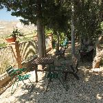 Sit here and unwind with a chilled glass of local wine - all you can hear are the chicada...