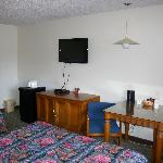 Guestroom with our new flat screen HDTVs and 3.5 cu ft fridge