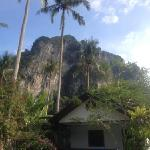 Air Con bungalow Ao Nang Dahla under limestone karst mountain.