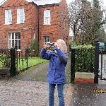 my partner taking a picture of Avenue Guest house because she liked it so much.