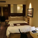 "The double bed in the Forus B ""Success"" room"