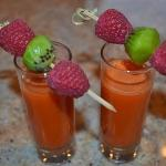  Fresh juiced shooters with fruit garnish