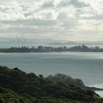 View from Mudbrick vineyard on Waiheke, looking over Motuihe Island towards Auckland CBD. Harbou