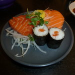 Three slices of premium Scottish salmon sashimi, two salmon nigiri and two salmon maki.