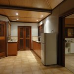 Kitchen and vanity area of bathroom through sliding doors