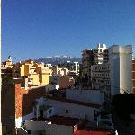 view from balcony with snow on the mountains