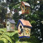 Mosaic birdhouses in the garden