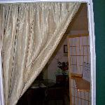 No door; just a curtain in den.