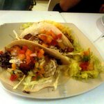 Two chicken soft tacos, one beef soft taco