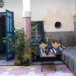 Entrance of one of the two double rooms seen from the patio