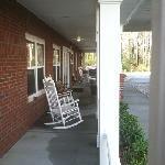  rocking chairs. view of the woods.