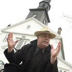 Tour guide Andy Smith telling a tale in front of St. Paul&#39;s Church in downtown Halifax.
