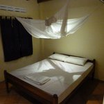 Inside our bungalow. Didn't need the mosquito net